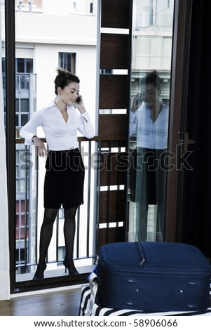 beautiful caucasian woman arriving phone call in a hotel bedroom - stock photo