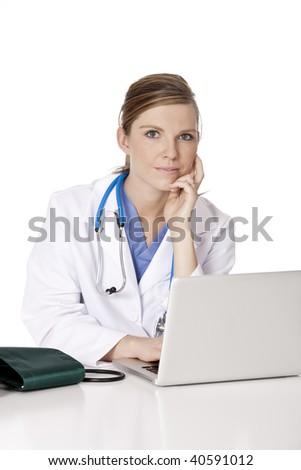 Beautiful Caucasian woman Doctor or Nurse working at a desk isolated on a white background - stock photo