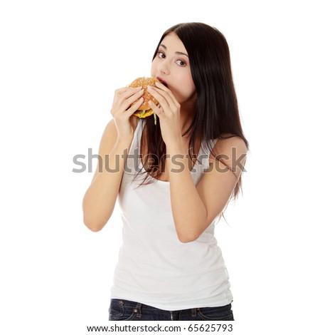 Beautiful caucasian woman eating hamburger. Isolated on white - stock photo