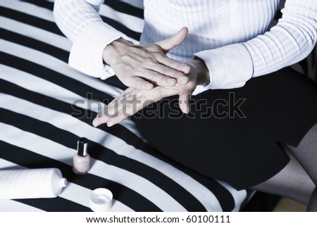 beautiful caucasian woman hand massaging with lotion - stock photo
