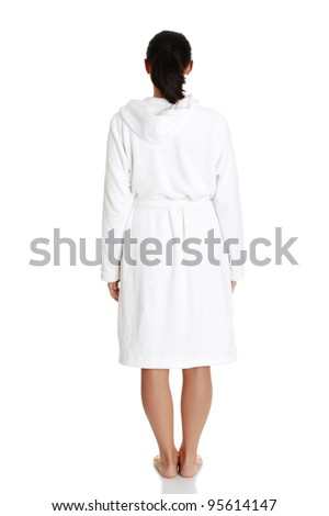 Beautiful caucasian woman in bathrobe standing back to the camera, isolated on white background - stock photo