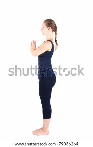 Beautiful Caucasian woman in blue Capri and top doing first step of surya namaskar, sun salutation Exercise at white background - stock photo
