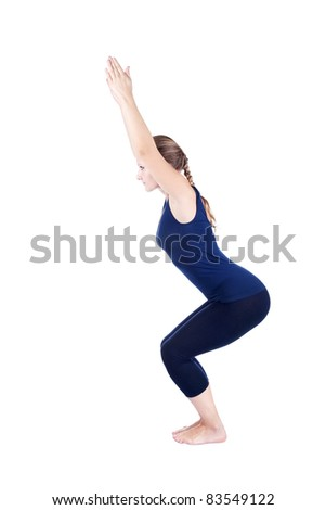 Beautiful Caucasian woman in blue Capri and top doing utkatasana, chair powerful pose at white background. Free space for text - stock photo