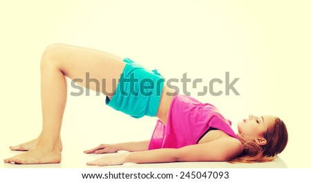 Beautiful caucasian woman is doing exercises.  - stock photo