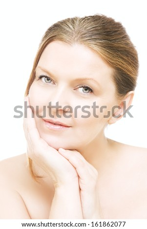 beautiful caucasian woman looking at camera, mid adult female face - Portrait of happy aged woman - stock photo