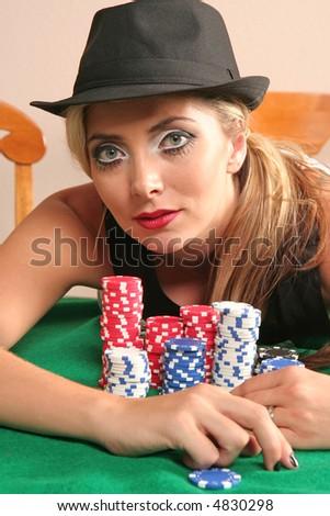 Beautiful caucasian woman showing off her winnings in poker - stock photo