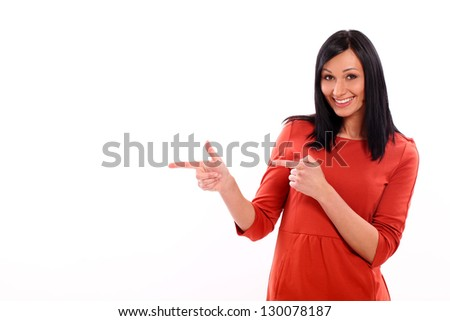 Beautiful caucasian woman shows on something isolated over white background - stock photo
