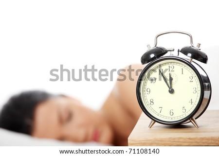 Beautiful caucasian woman sleeping in the morning. - stock photo
