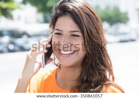 Beautiful caucasian woman speaking at phone - stock photo