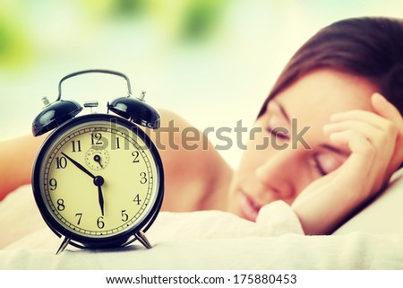 Beautiful Caucasian woman waking up in the morning. - stock photo
