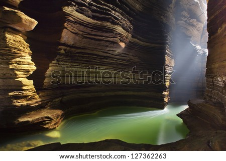 Beautiful cave with lake - stock photo