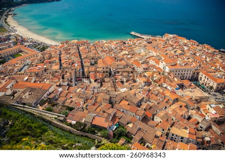beautiful Cefalu coast and its orange roofs from bird's eye view, Sicily - stock photo