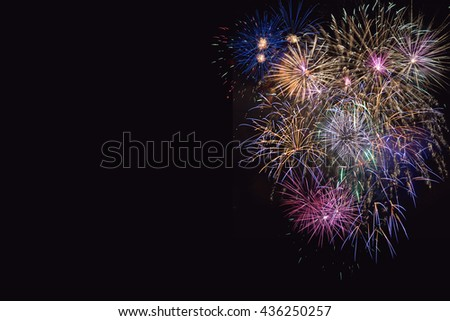 Beautiful celebration  lilac, purple and golden fireworks. 4th of July beautiful fireworks. Independence Day, Canada Day, New Year holidays salute, copy space.  - stock photo