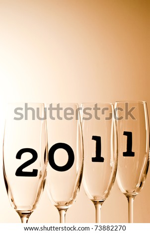 beautiful champagne glasses with 2011 inside - stock photo
