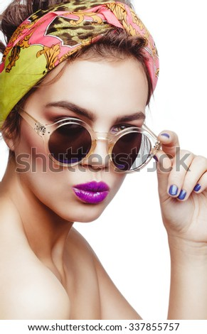 Beautiful charming attractive brunette model wearing shawl on her head and sunglasses, nude makeup, purple lips. - stock photo