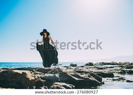 Beautiful charming girl posing against the blue sky during summer time - stock photo