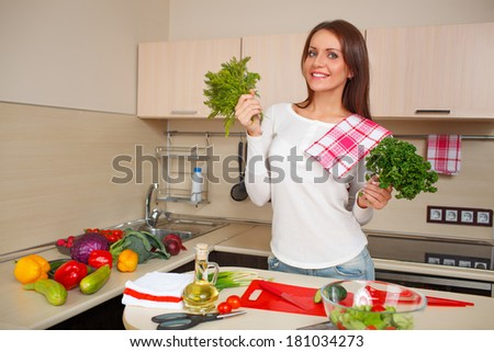 beautiful cheerfu caucasian young woman at home making salad - stock photo
