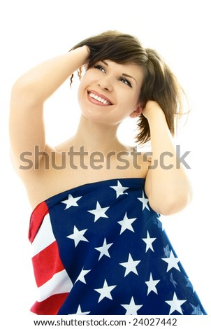 beautiful cheerful young nude woman wrapped into an American flag, isolated against white background - stock photo