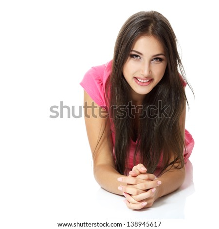 Beautiful cheerful young woman lying down and smiling. Isolated on white background - stock photo