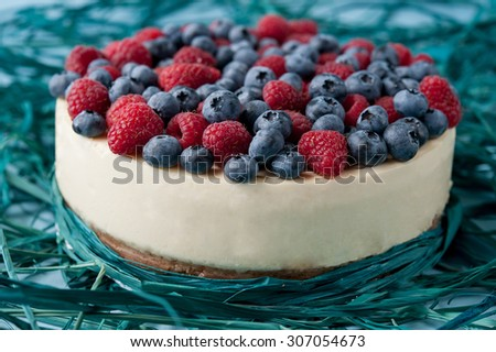 beautiful cheesecake with raspberries and blueberries - stock photo