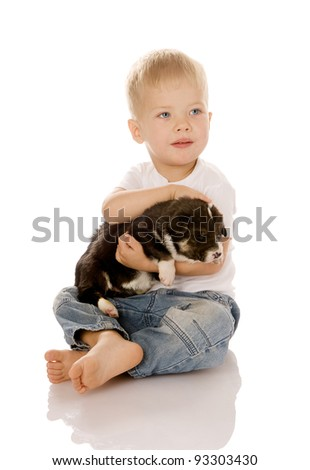Beautiful child embracing a cute dog. isolated on white background - stock photo