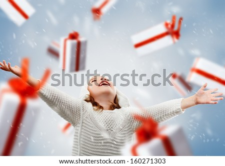 beautiful child opens a gift - stock photo