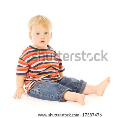 Beautiful child sitting. Isolated on white background - stock photo