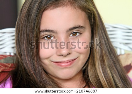 Beautiful child smiling with brown eyes. - stock photo