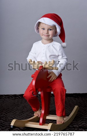 beautiful child with rocking horse - stock photo