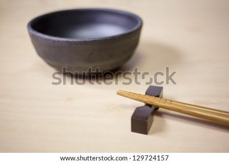 Beautiful chopsticks on wooden table - stock photo