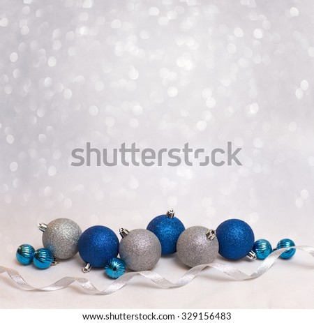 Beautiful Christmas background with blue and white christmas balls for xmas design - stock photo