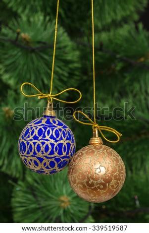 Beautiful Christmas balls on  background of green fir-tree - stock photo