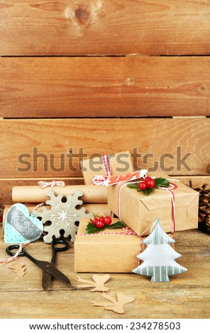 Beautiful Christmas composition with handmade gifts on wooden background - stock photo