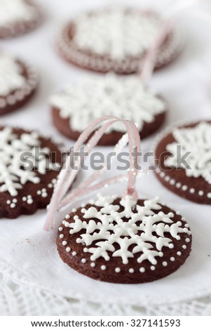 Beautiful christmas cookies decorated with icing snowflakes, selective focus - stock photo