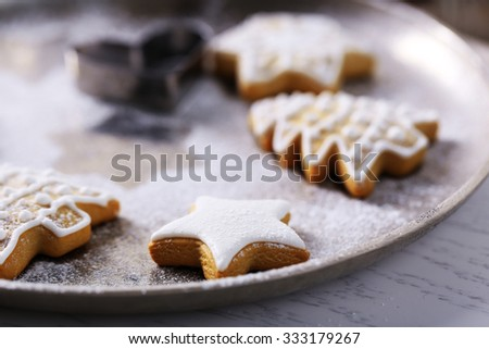 Beautiful Christmas cookies on oven-tray, close up  - stock photo