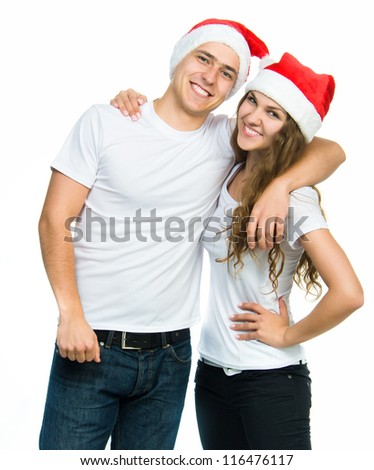 Beautiful Christmas couple in Santa hats on a white background - stock photo