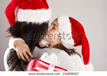 Beautiful christmas family is posing in studio - stock photo
