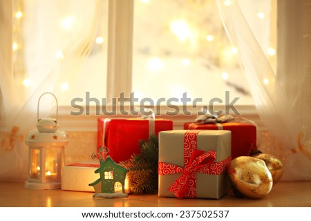 Beautiful Christmas gifts on windowsill - stock photo
