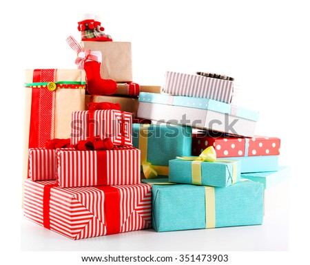 Beautiful Christmas gifts with toys isolated on white background - stock photo