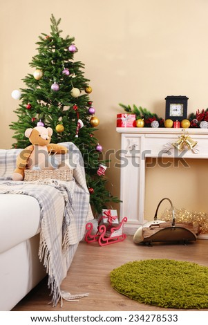 Beautiful Christmas interior with decorative fireplace and fir tree - stock photo