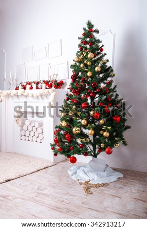 Beautiful Christmas living room with tree and fireplace - stock photo