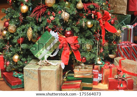 Beautiful Christmas presents in front of the tree  - stock photo