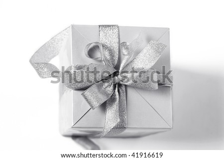 Beautiful Christmas Silver gift box with a bow - stock photo