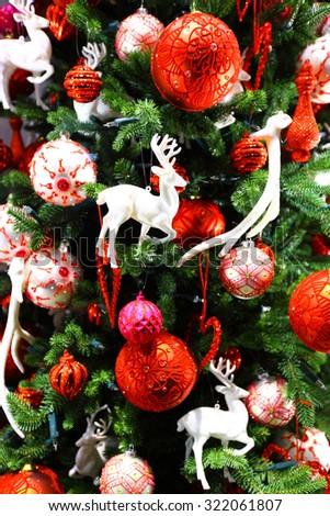 Beautiful christmas tree decor with balls ans deers - stock photo
