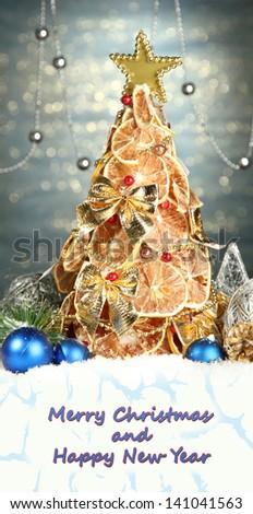 Beautiful Christmas tree of dry lemons with decor - stock photo