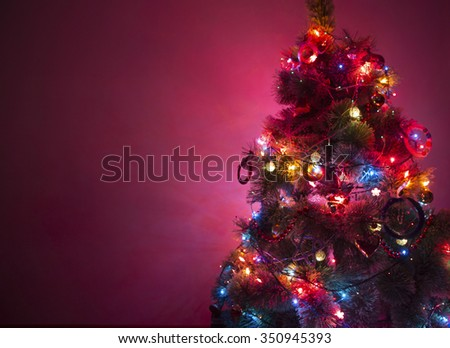 beautiful christmas tree with Multi Colored Lights  on dark background - stock photo