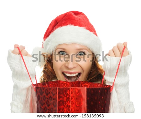 Beautiful christmas woman in santa hat with a bag in hand on a white background. - stock photo