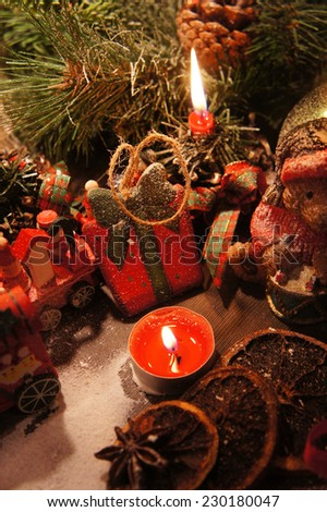 Beautiful Christmas wreath with candles and toys       - stock photo