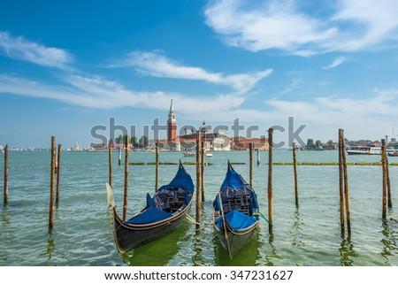 Beautiful Church of San Giorgio Maggiore and gondolas, Venice, Italy, summer 2015 - stock photo