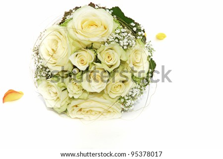 Beautiful circular bridal bouquet of fresh white roses and dainty gypsophylla - stock photo